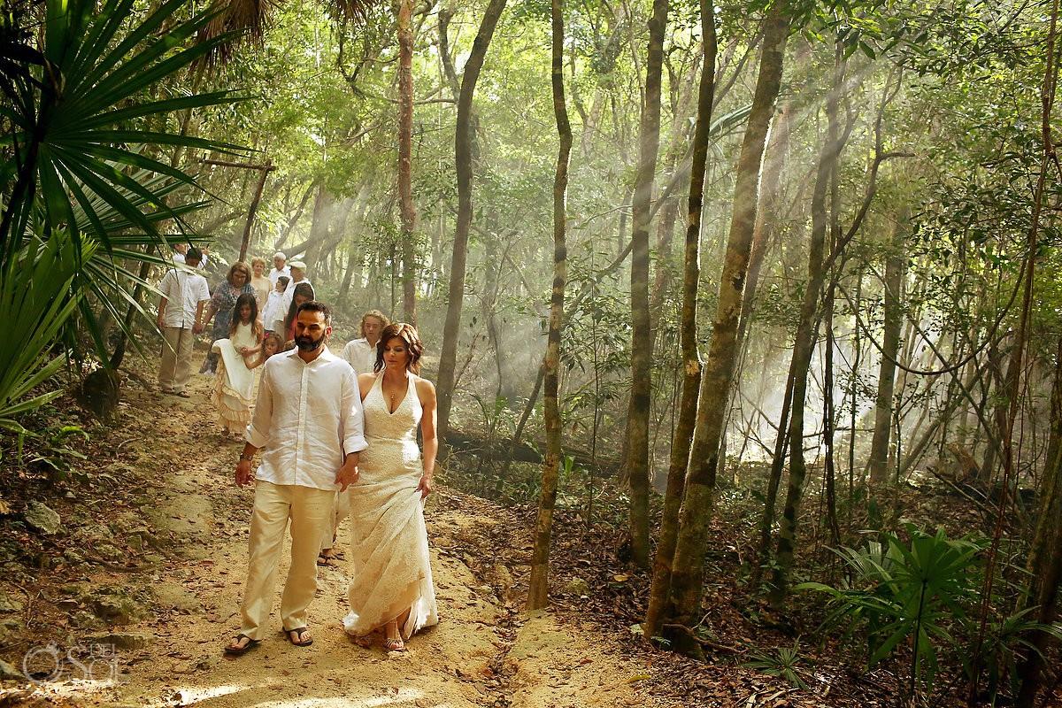 bride and groom walking Special 20 year vow renewal cenote Mayan ceremony Riviera Maya Mexico