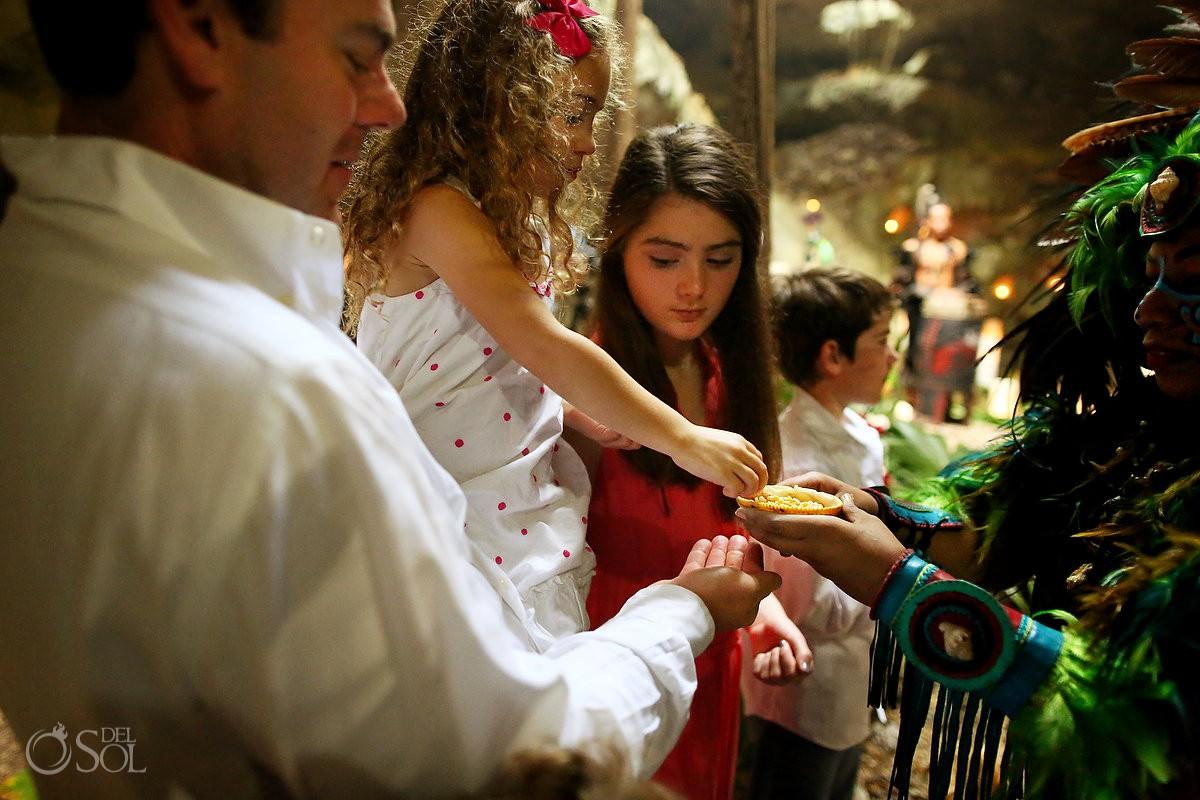 kids enjoying Special 20 year vow renewal cenote Mayan ceremony Riviera Maya Mexico