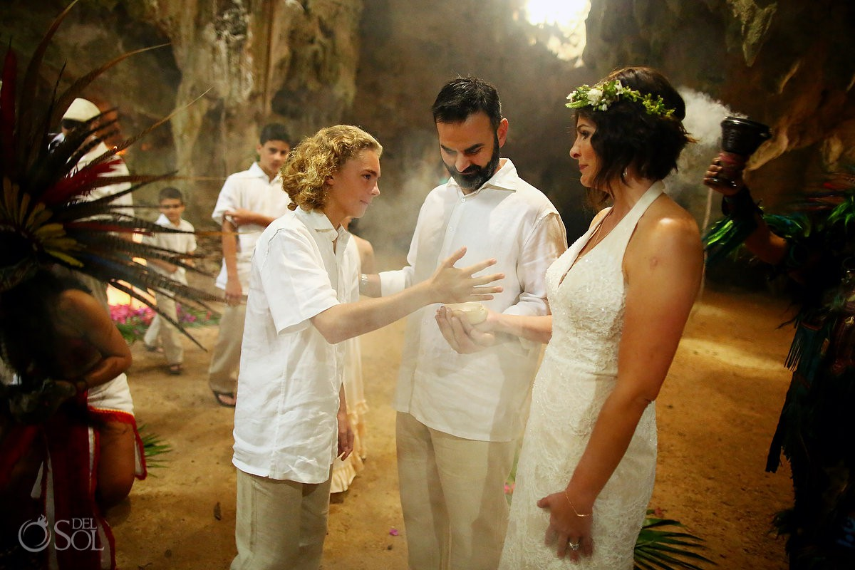 Bride and groom son's participating Special 20 year vow renewal cenote Mayan ceremony Riviera Maya Mexico