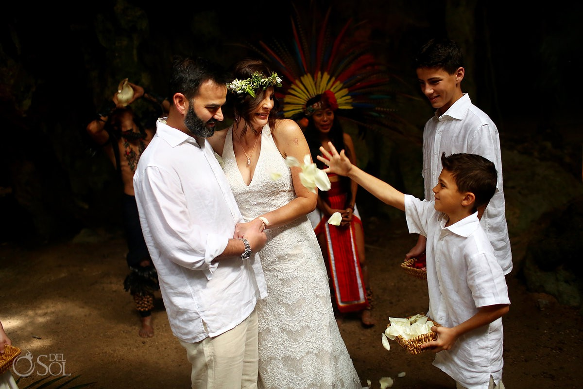 bride and groom son's blessing parents Special 20 year vow renewal cenote Mayan ceremony Riviera Maya Mexico