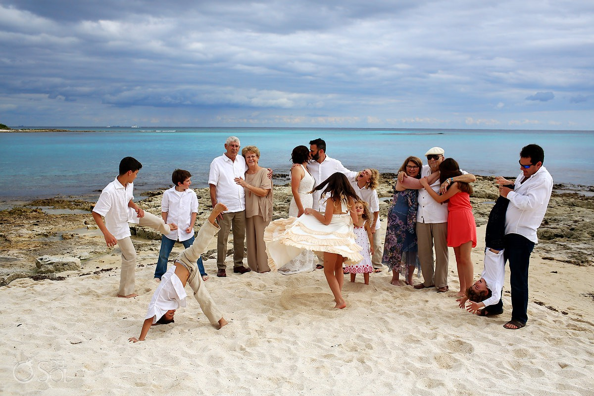 Bride and groom family beach wedding portraits Special 20 year vow renewal Riviera Maya Mexico