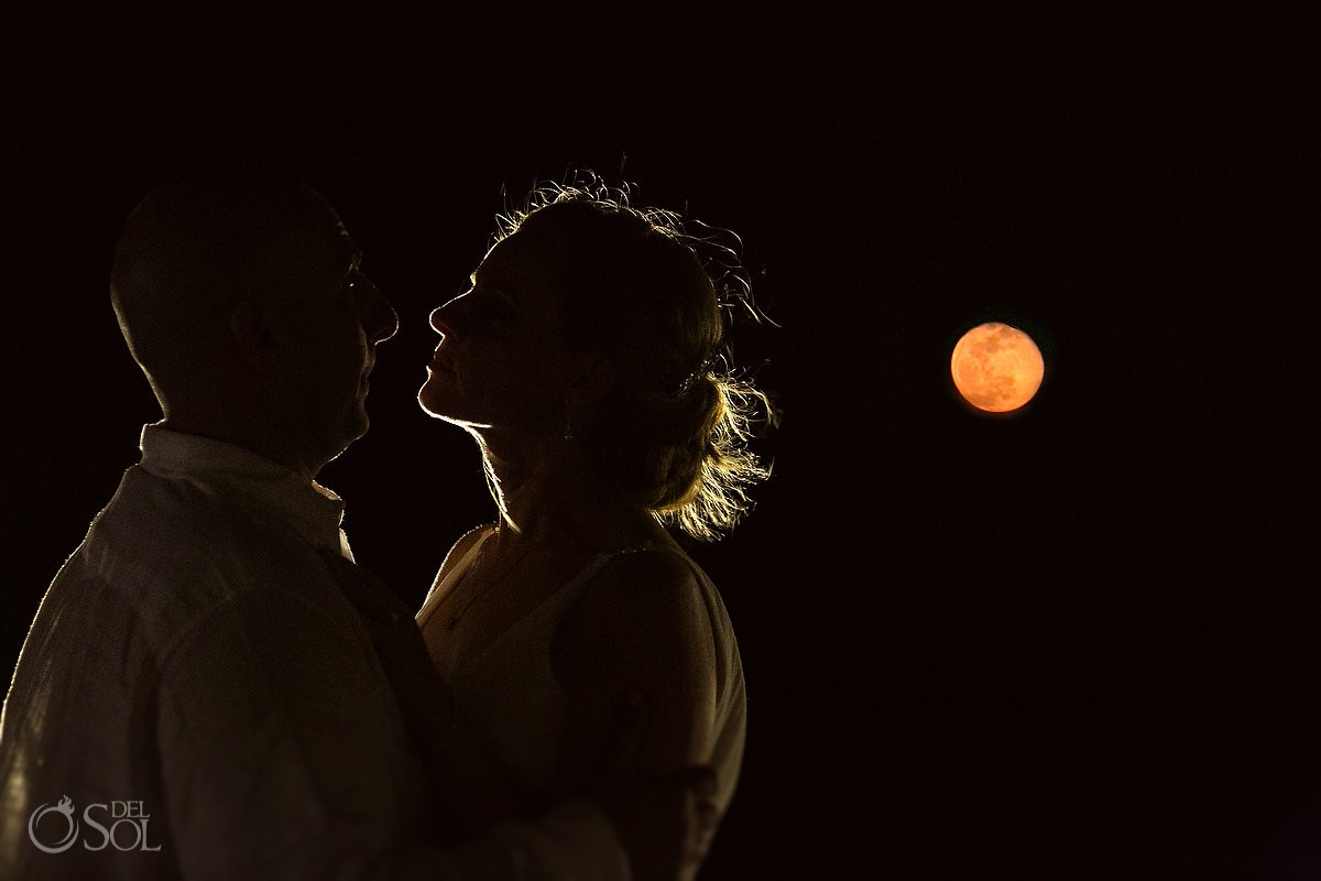 Bride and groom full moon best destination wedding places Dreams Riviera Cancun Resort