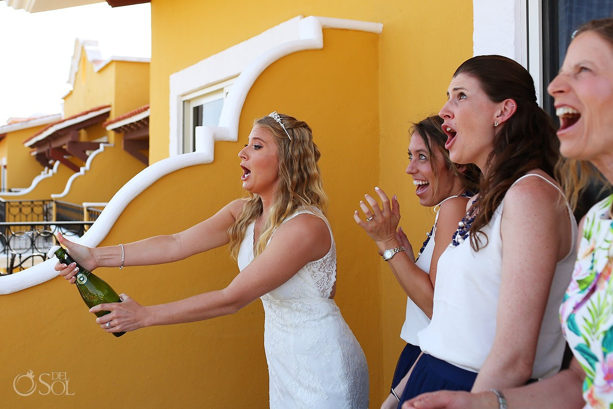 funny wedding photo bride opening champagne