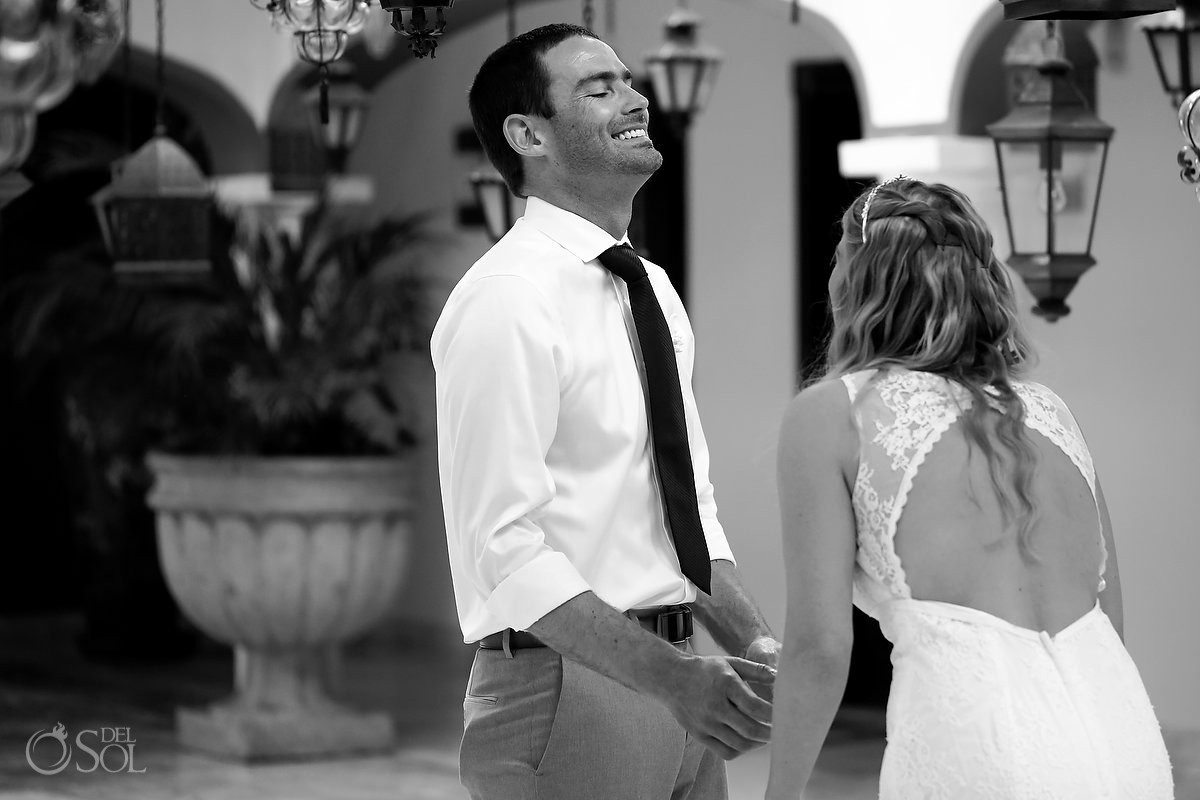 Black and white wedding photo first look Secrets Capri Riviera Cancun