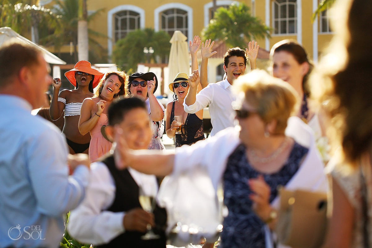 wedding photography photojournalism Secrets Capri hotel guest cheering wedding party