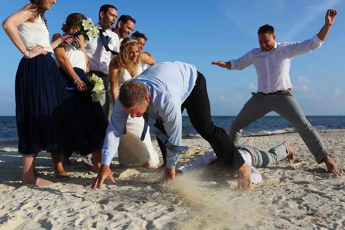 Bridal party goofing around funny wedding photo Secrets Capri Riviera Maya