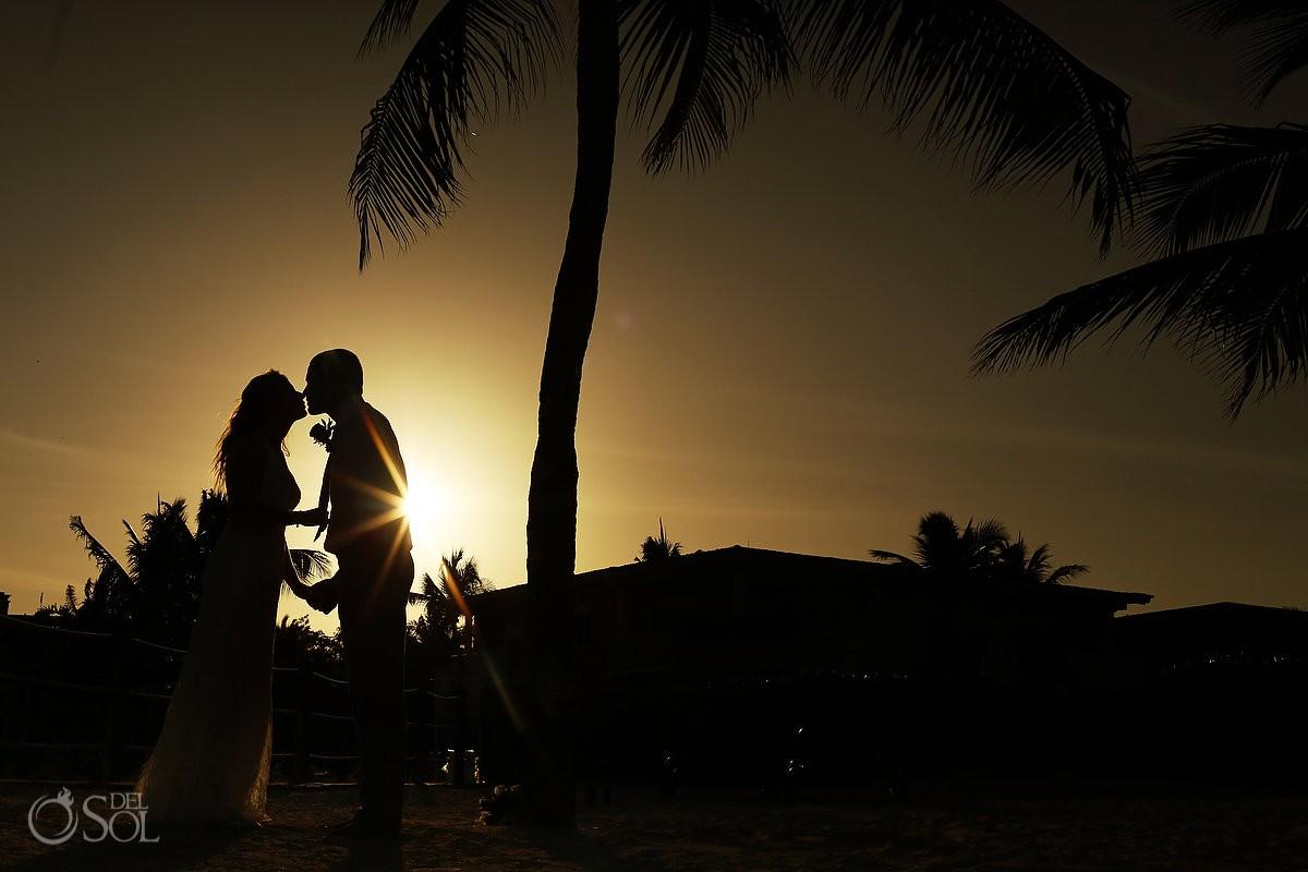 Secrets Capri Wedding photographer sunset bride and groom silhouette