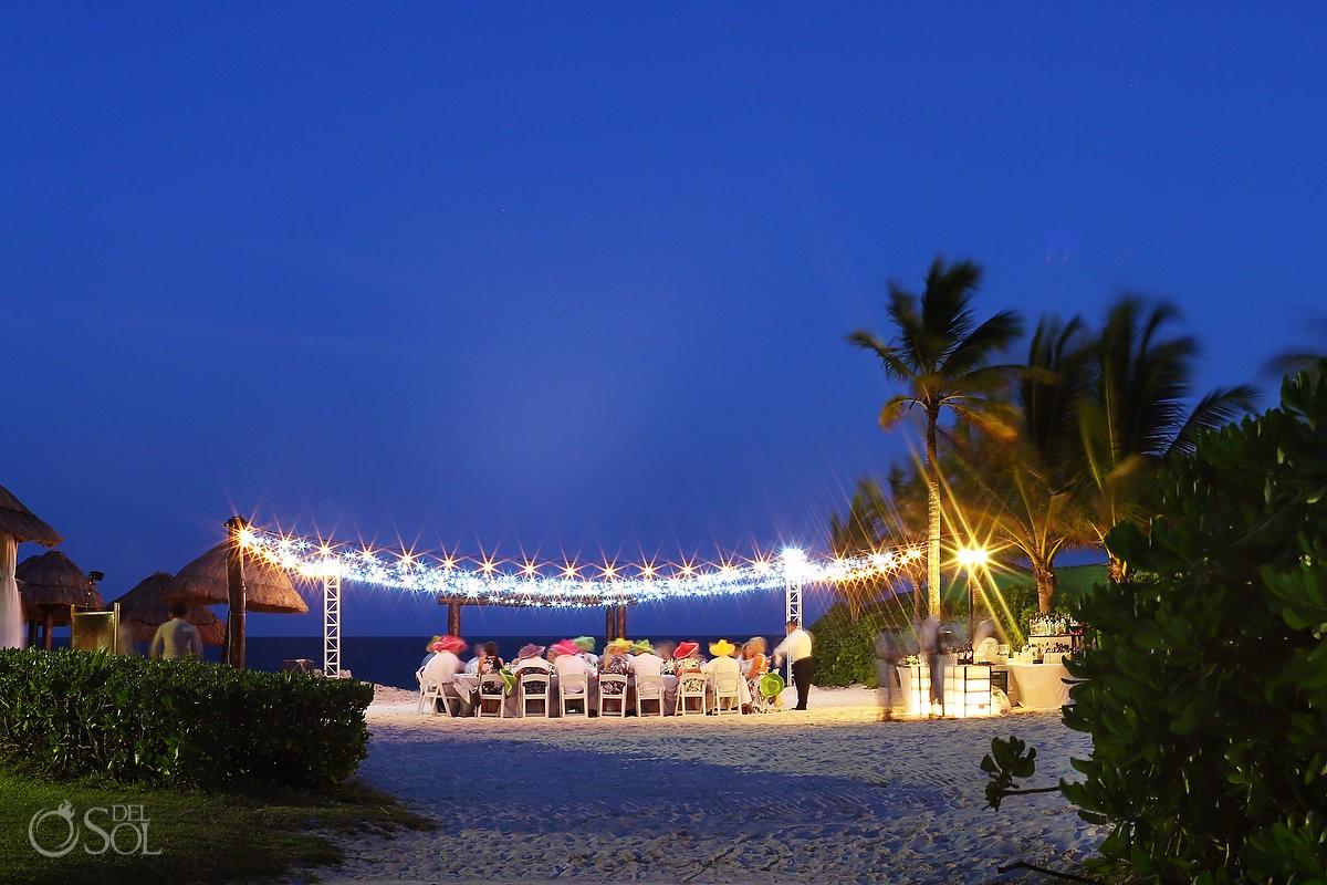 Secrets Capri beach wedding reception set up fairy lights long exposure