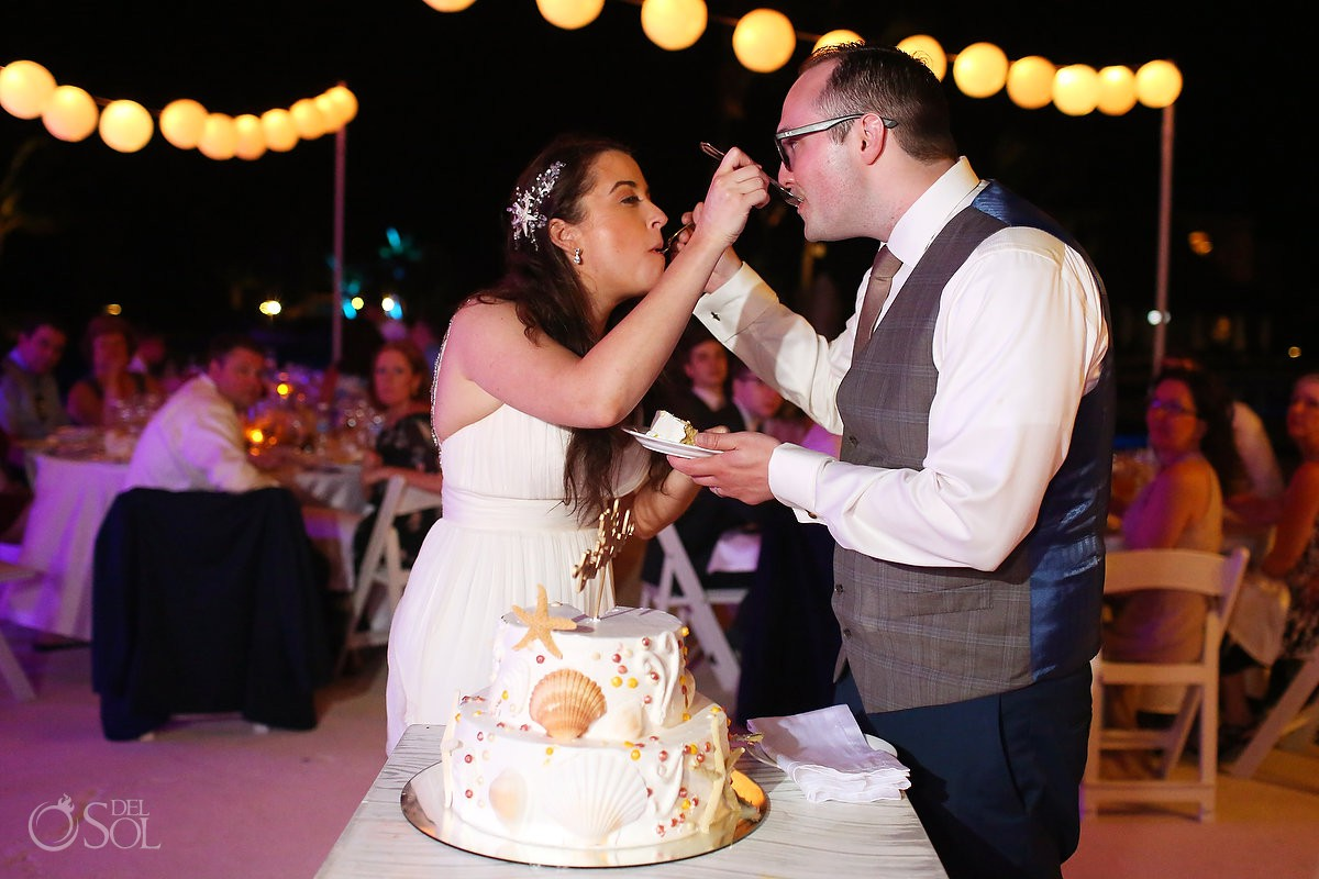 Bride and groom cake cutting reception ideas Wedding Secrets Maroma Beach Riviera Cancun Mexico