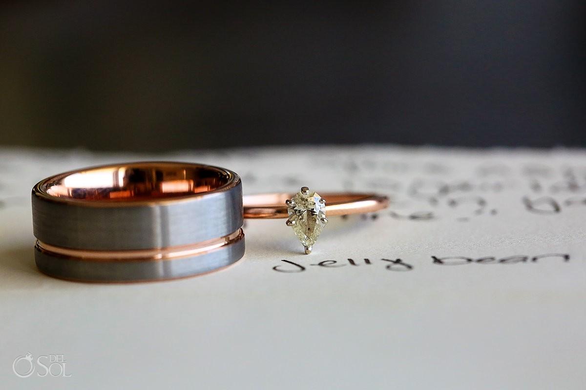 rose gold wedding band engagement ring teardrop diamond macro photo