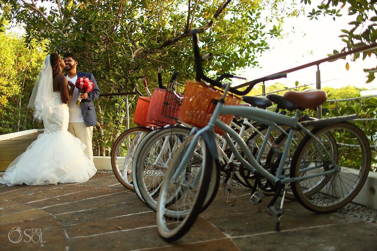 Bride and groom beside bicycles Blue Diamond Wedding