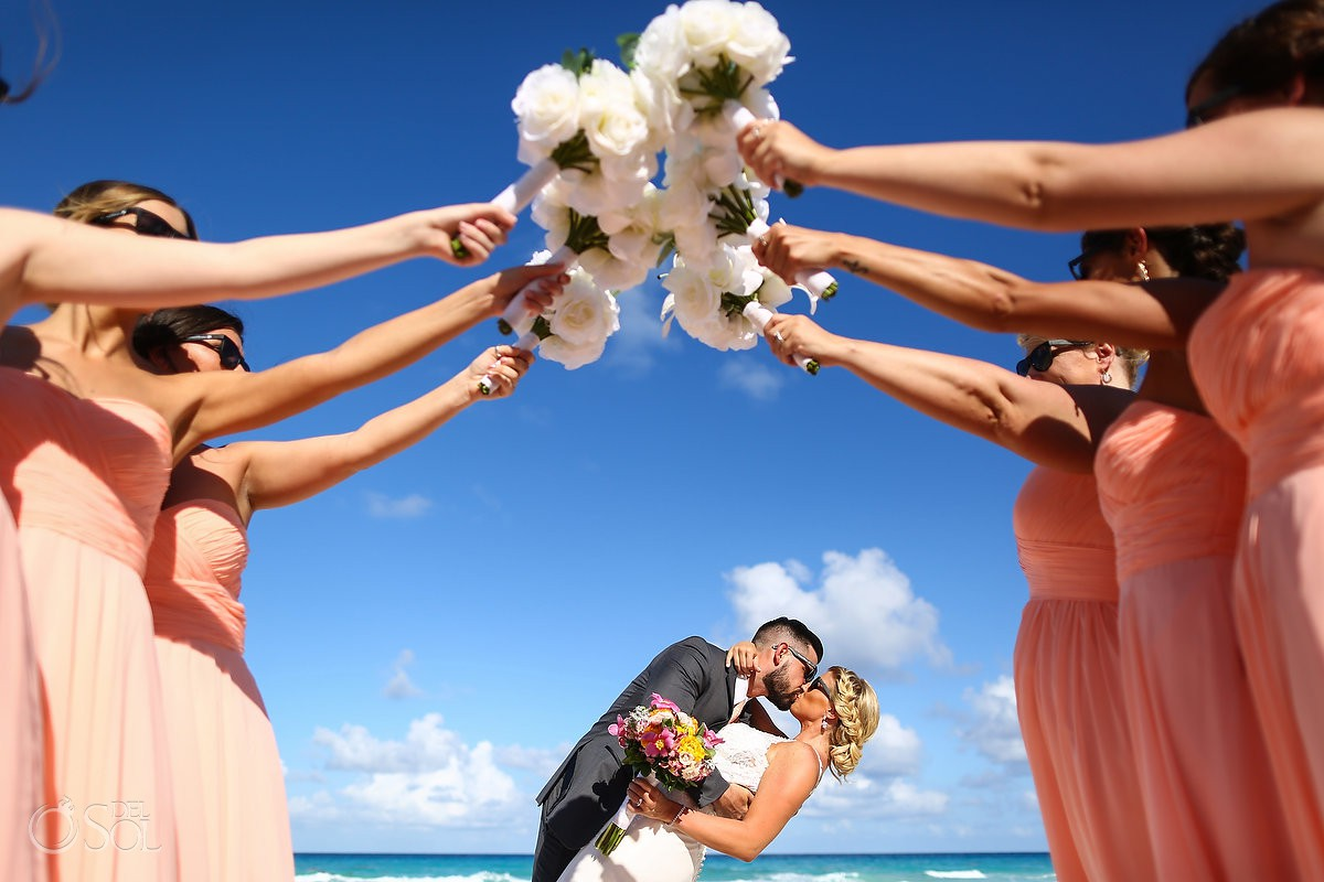 bridal party photo idea bridesmaids bouquet couple kiss Beach Palace Wedding Cancun Mexico