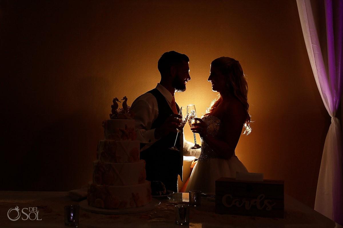 cake curtting couple portrait silhouette ballroom Beach Palace Wedding reception Cancun Mexico