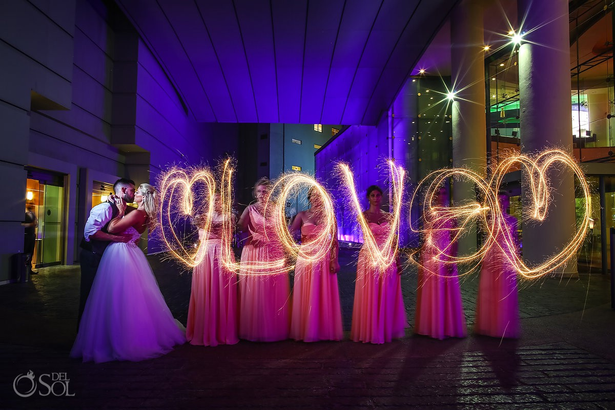 Light painting with sparklers love wedding party photo ideas Beach Palace Cancun