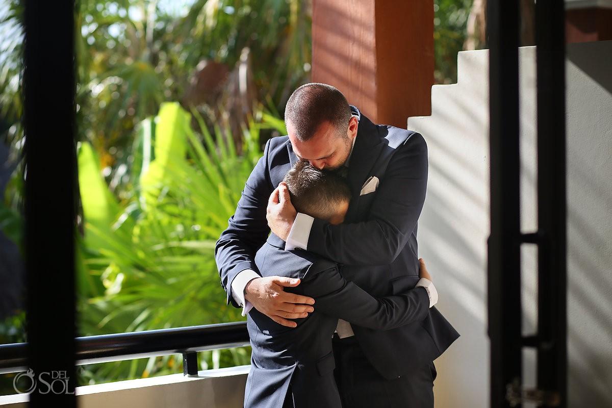 groom hugging son getting ready Now Sapphire Hidden Beach Wedding