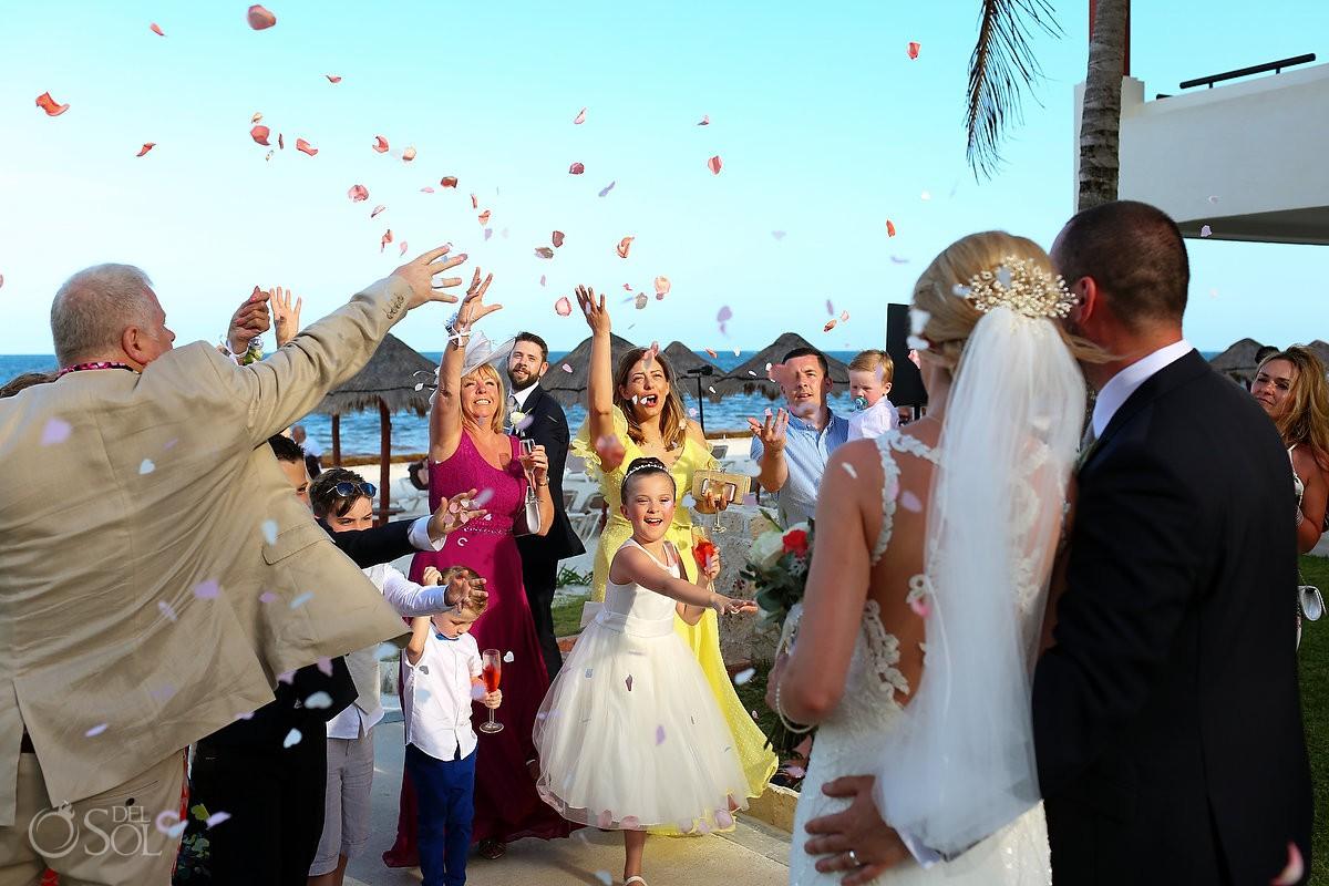Wedding guests throwing flower petals Mexico Destination wedding