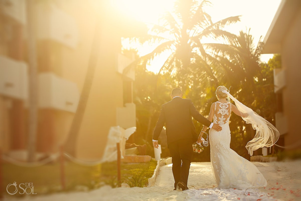 Sunset portrait candid bride and groom walking Now Sapphire Riviera Maya Mexico