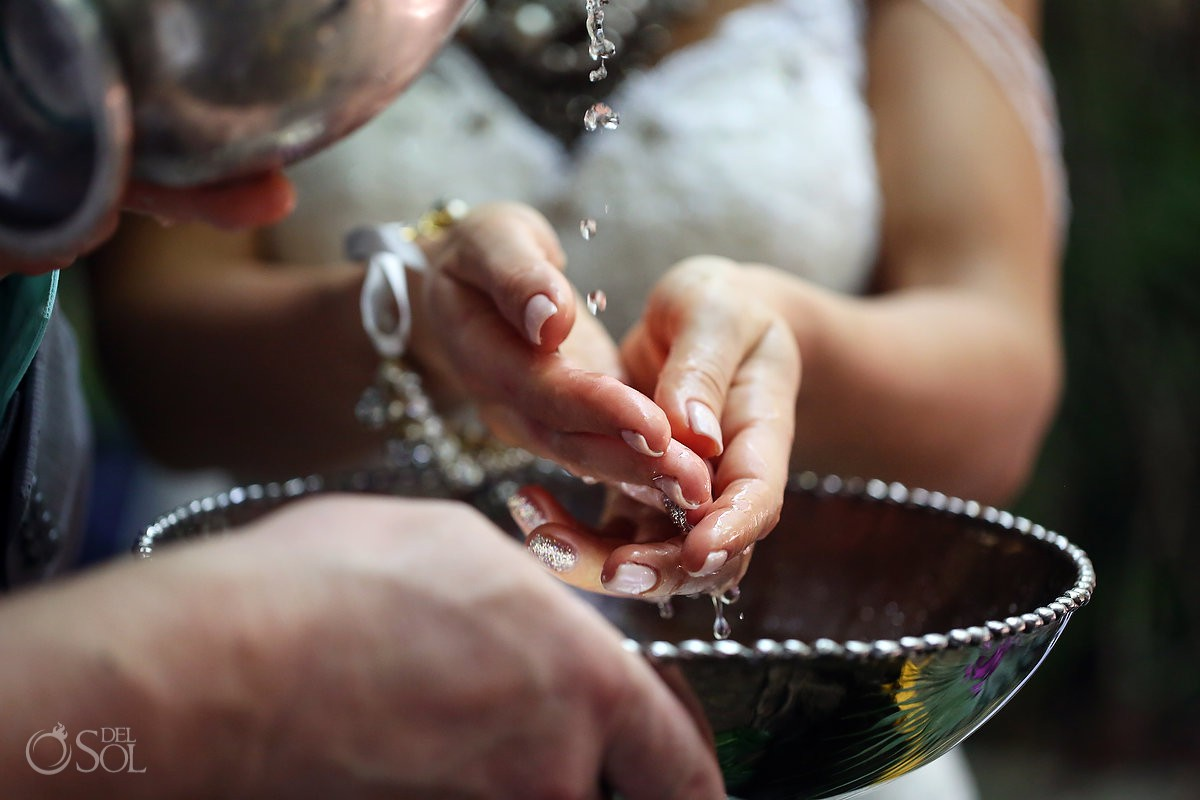 purification of the hands underwater wedding photography