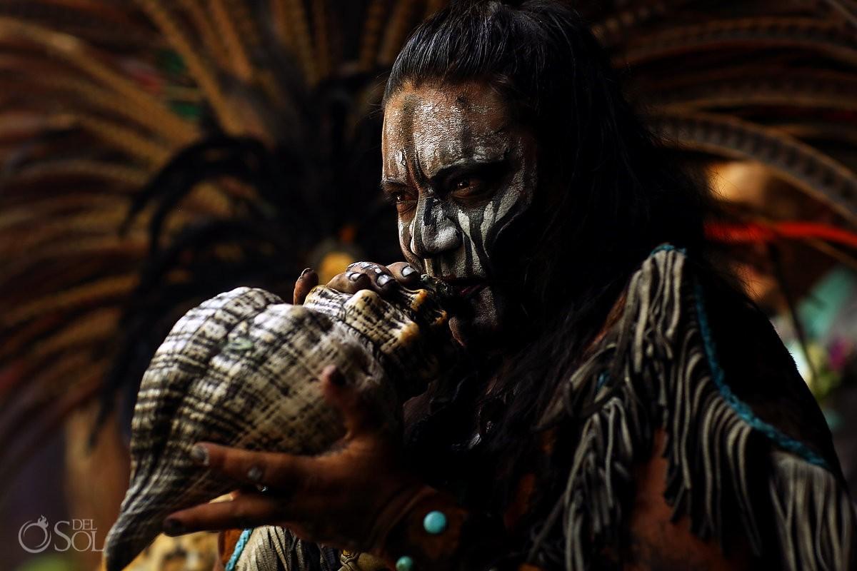Mayan musician blowing conch shell cenote elopement Riviera Maya Mexico