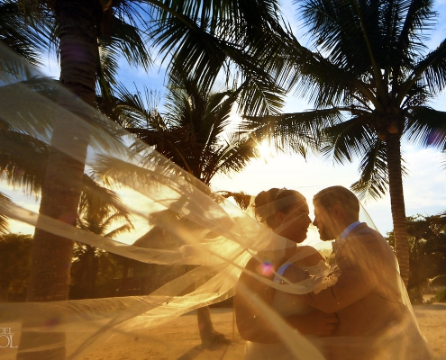 Sunset golden hour Akumal Bay Destination Wedding bride groom portrait