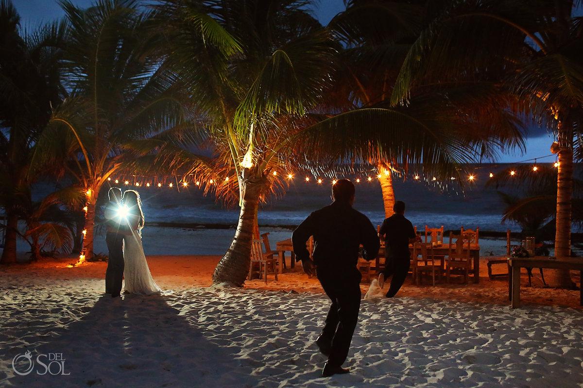 wedding portrait waiters running from the rain Casa Malca Tulum Wedding