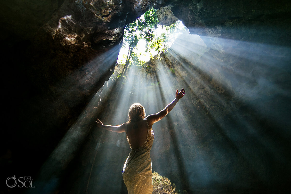 Adventure in Nature bride with open arms blessed by rays of light Riviera Maya Mexico