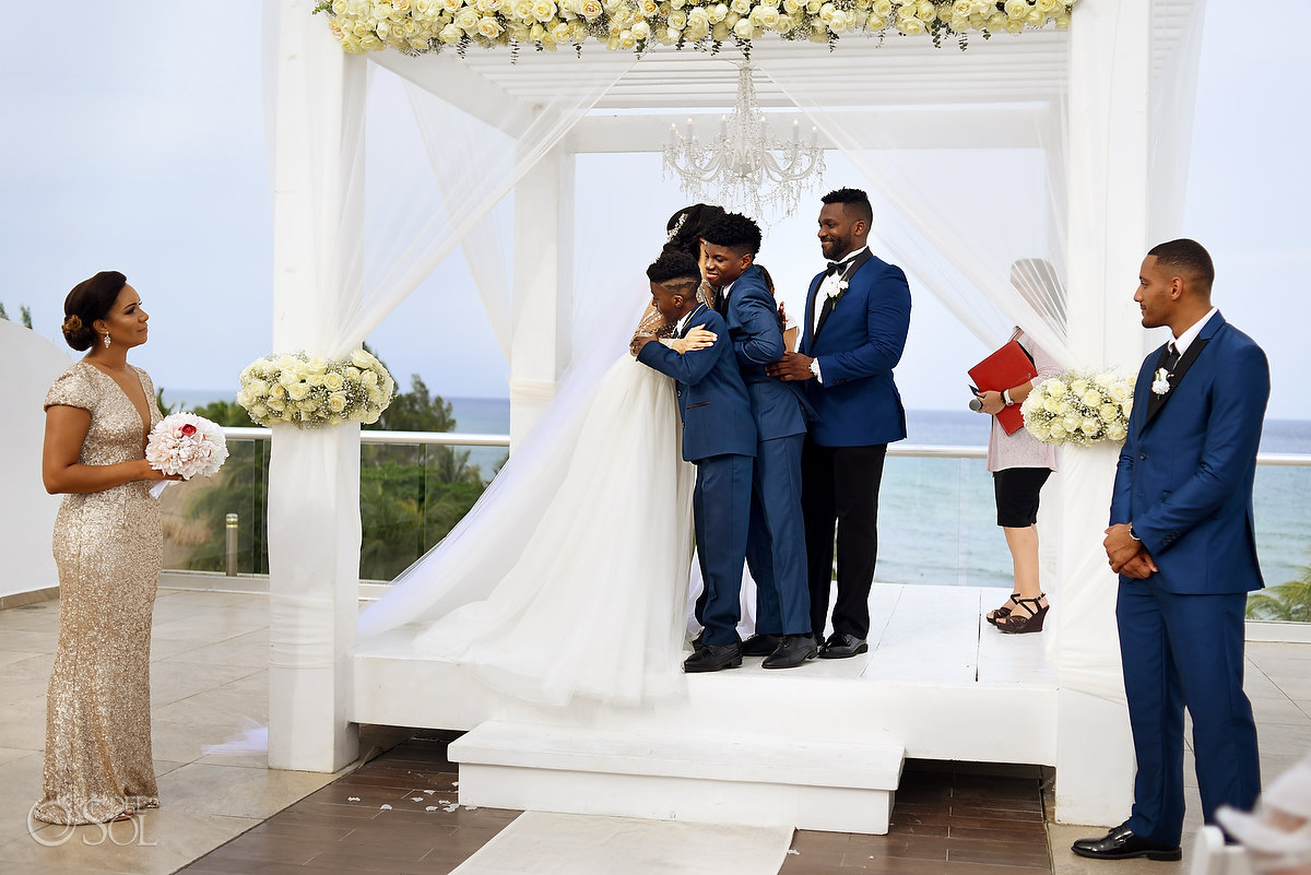 Altar Family Hug After Bride Gift L'Fay Bridal Tulle Transparencies Embroidered Sparkling Stones Long Vail Groom wearing A Suit That Fits