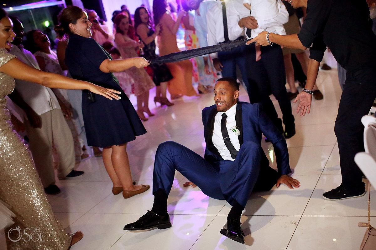 Azul Fives Ballroom Reception Groomsman Playing Limbo