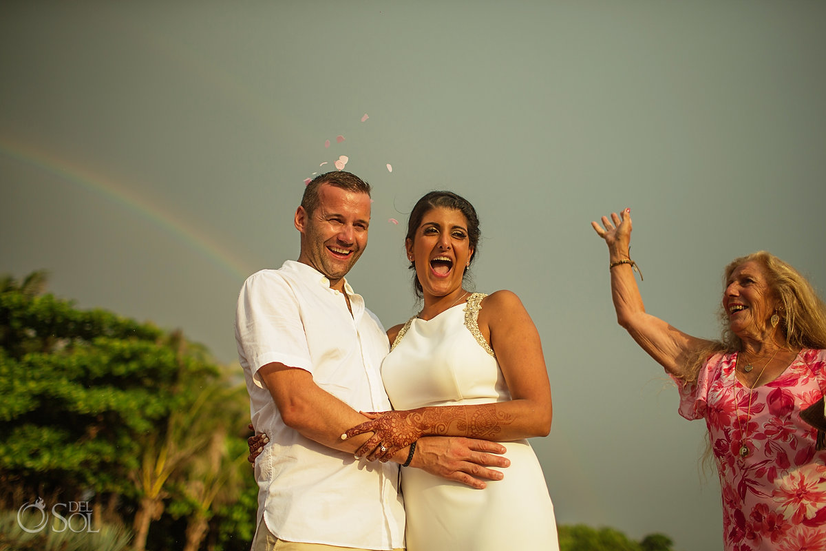 Groom and Bride sky Rainbow celebration