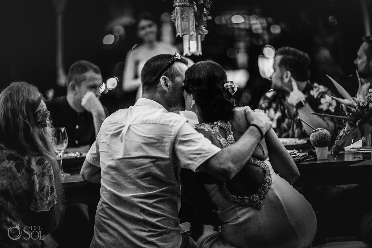 Groom and Bride romantic Kiss at Dinner Reception