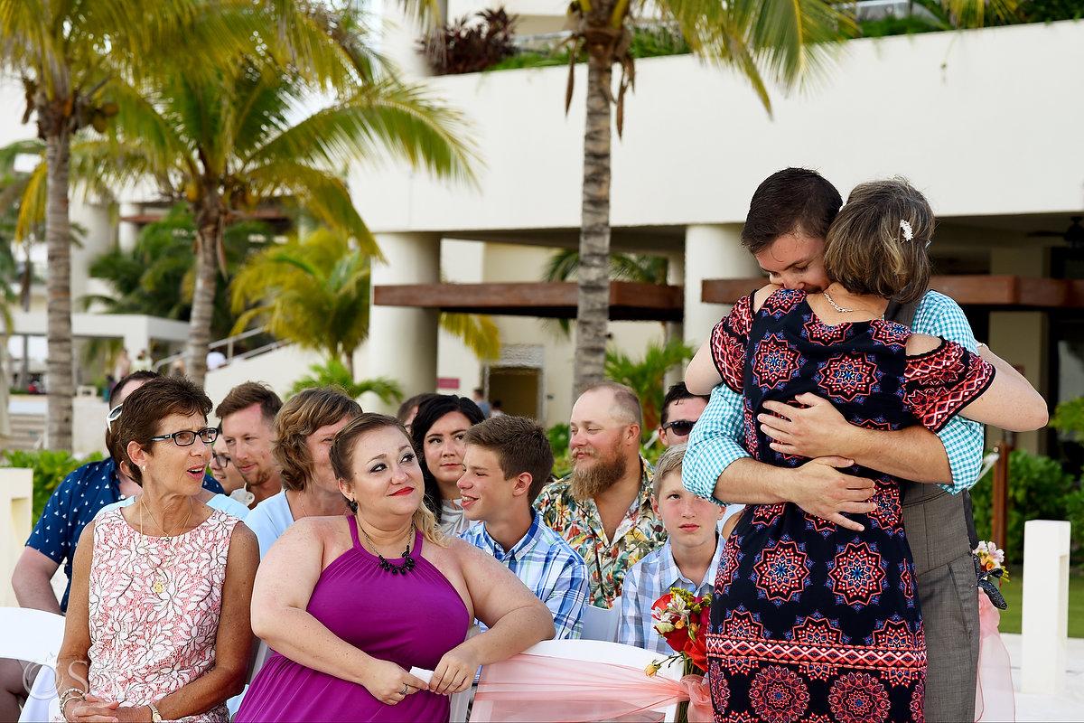 groom hugs mom Hyatt Ziva Cancun Fire Pits Wedding
