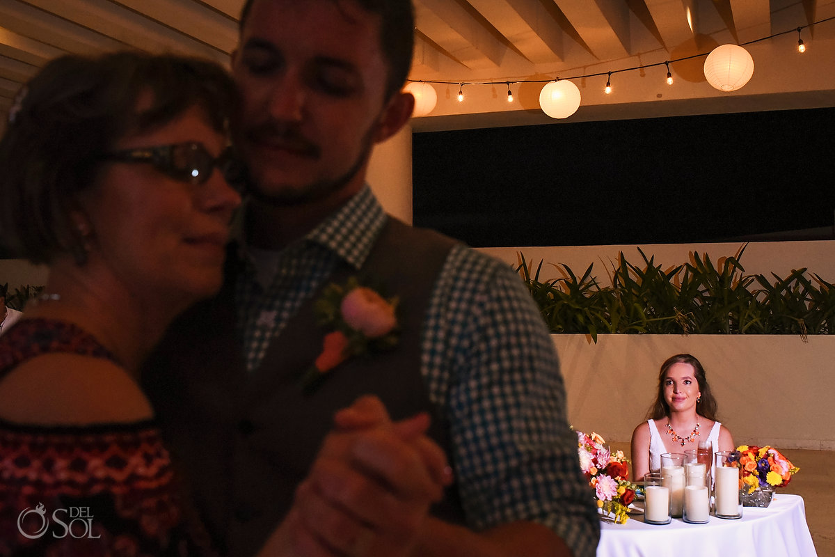 bride watches groom dance with mother destination wedding reception Hyatt Ziva Sky terrace