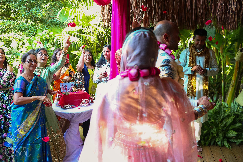 guest throwing flower petals Indian wedding ceremony