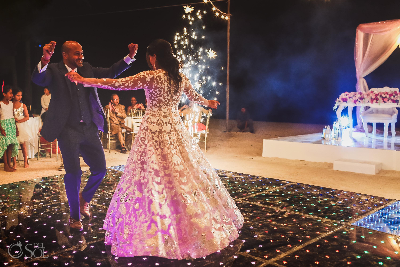 Bride and groom first dance between fireworks Dreams Tulum Indian wedding
