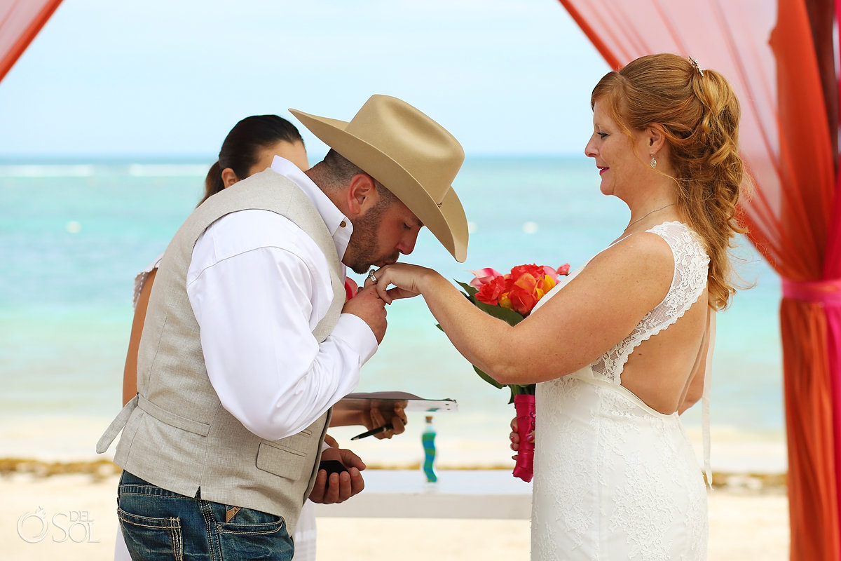 cowboy groom kisses bride hand Secrets Akumal Elopement Riviera Maya Mexico