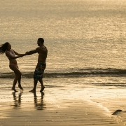 Lovers at sunset Dreams Las Mareas Beach Portrait photo