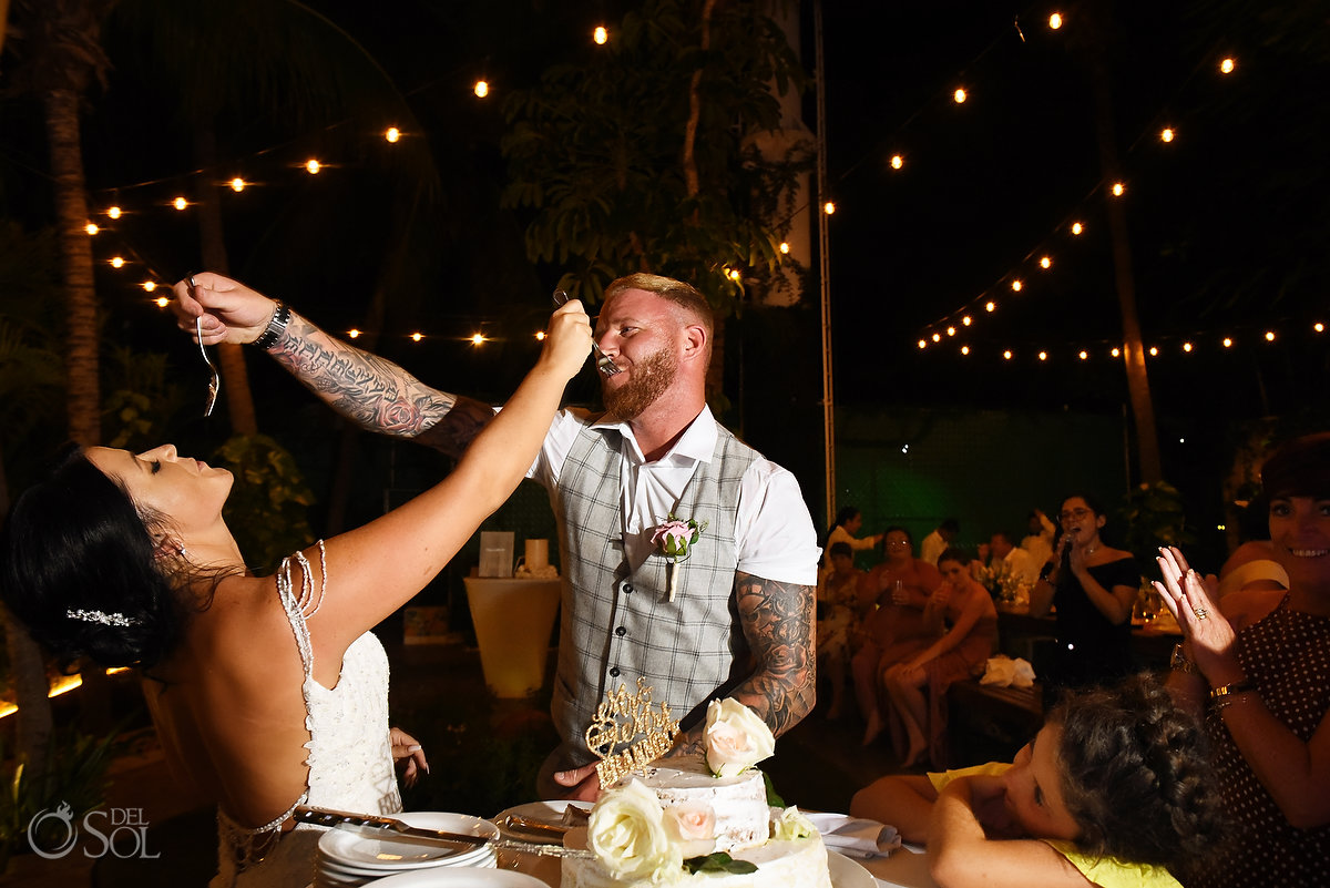 Cake feeding each other Wedding Reception Wayak Garden Dreams Sands