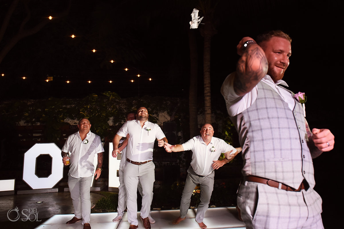 Groom Throws Garter Wedding Party Guys Wayak Garden Dreams Sands Cancun Mexico