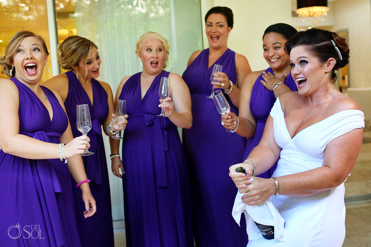 Paradisus bridal suite getting ready champagne toast purple bridesmaids dresses