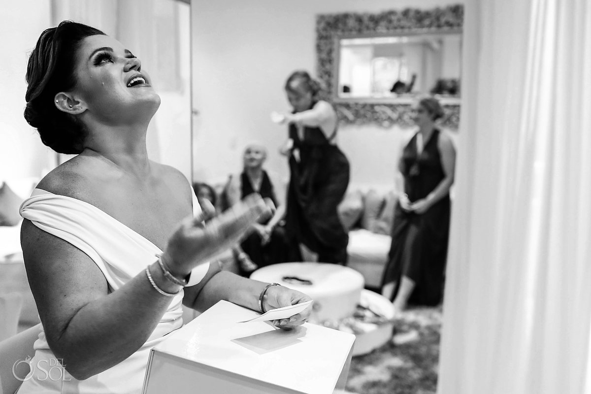 wedding day gifts bride holding back tears Paradisus bridal suite getting ready