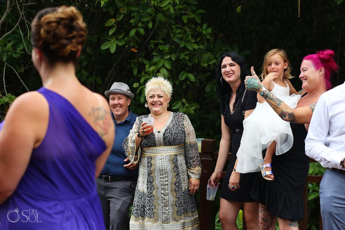 wedding guests give thumbs up to bridesmaid