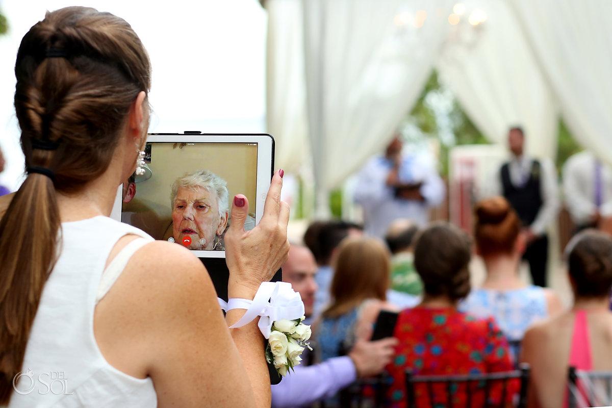 grandma watching wedding ceremony live by Skype