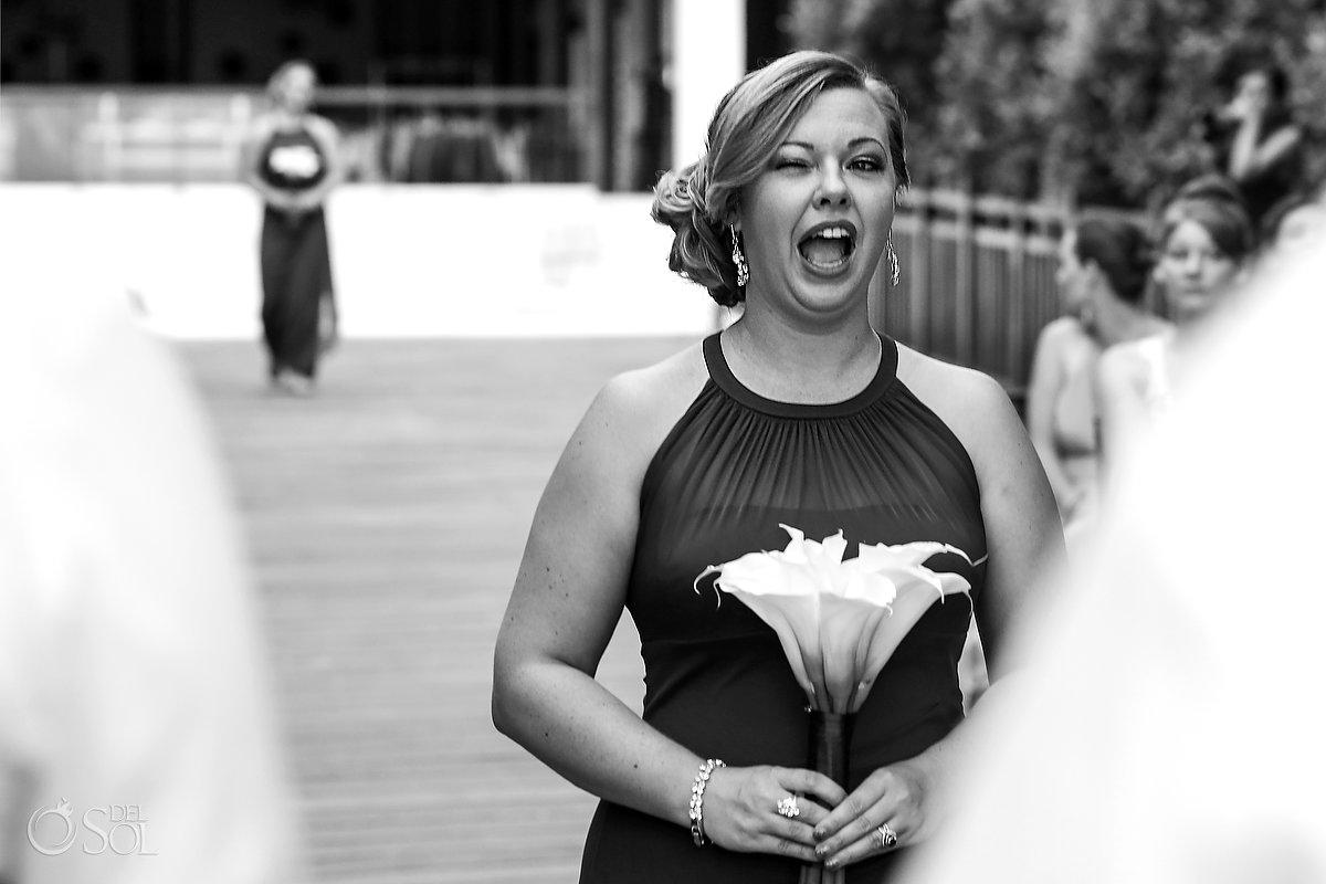 funny wedding photo bridesmaid wink at groom