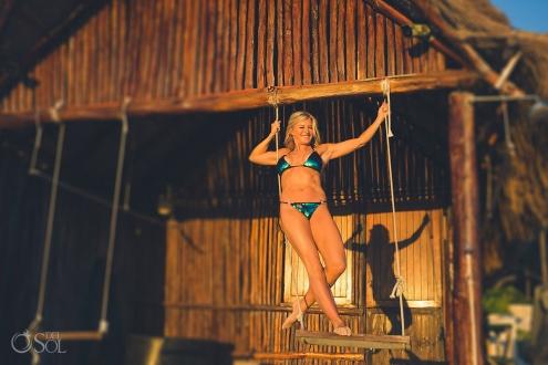 standing in swing Allison Dunbar bikini model