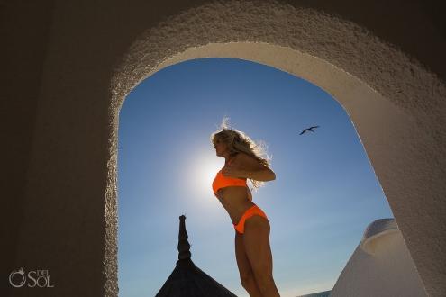 Allison Dunbar bikini model with pelican at Belmond Maroma