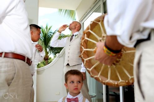 groom performs pre-wedding ceremony by breathing alcohol Dreams Tulum Spiritual Wedding