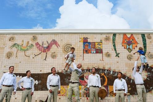 groom groomsmen bridal party portrait colorful wall crocodile mural Dreams Tulum Riviera Maya Mexico