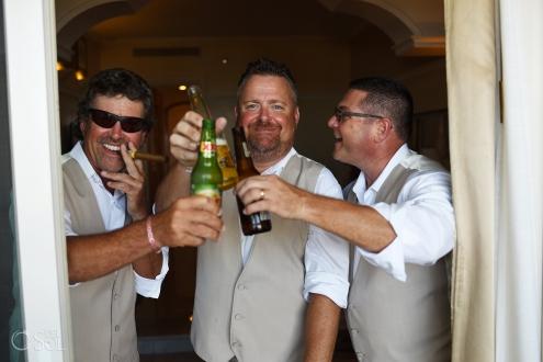 fun groomsmen photo beer toast Iberostar Grand Paraiso Wedding