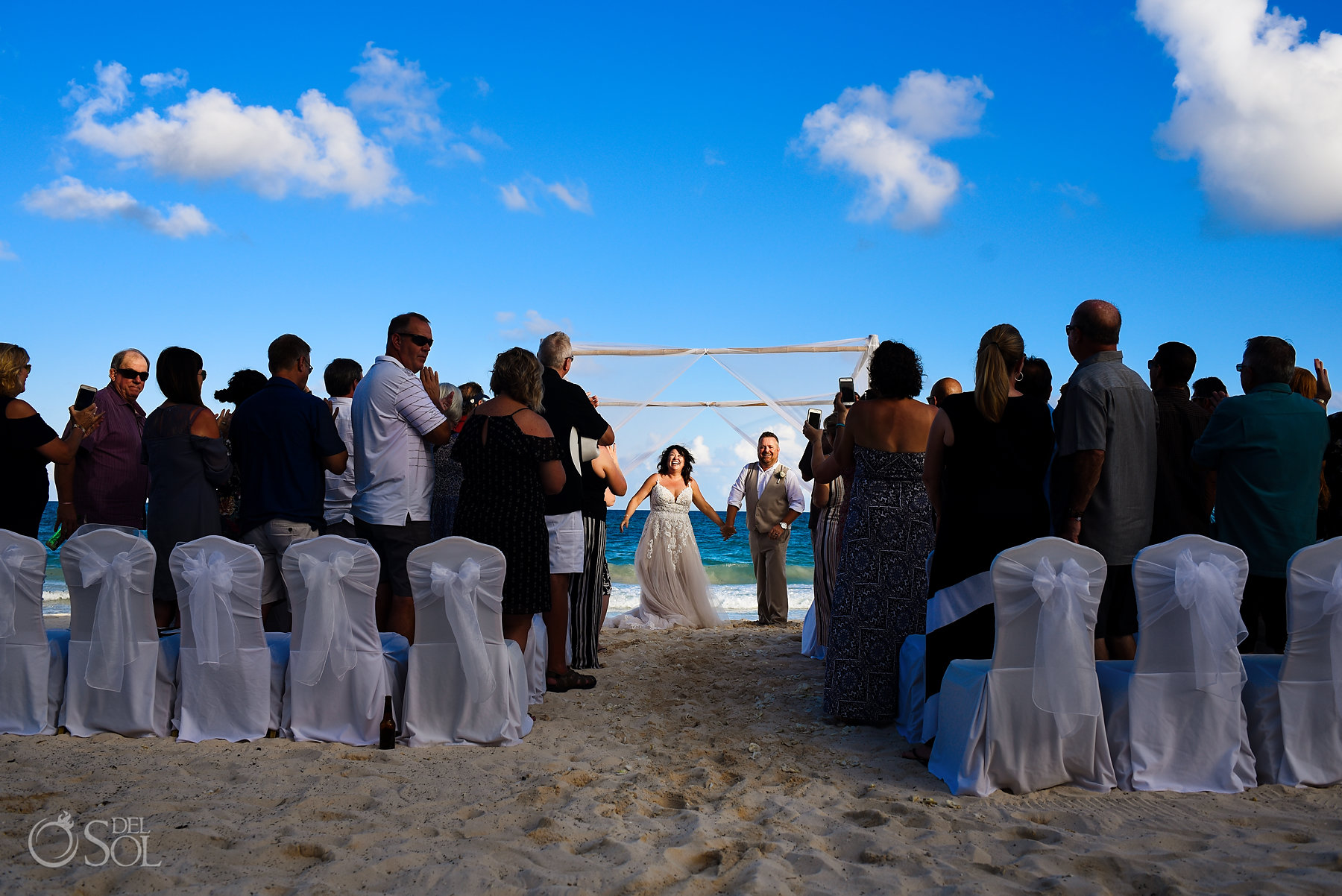 newly weds Iberostar Grand Paraiso wedding beach ceremony