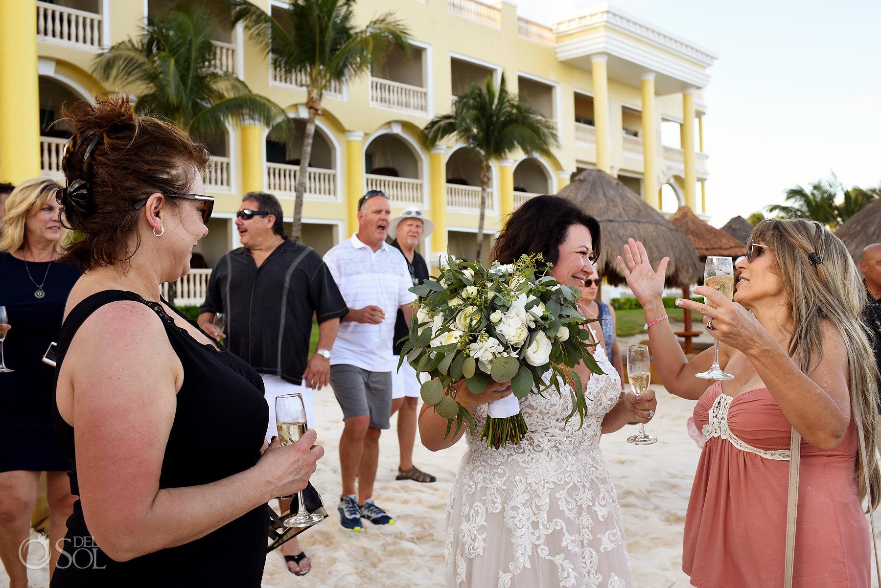 friends and family celebrating Iberostar Grand Paraiso wedding ceremony